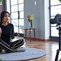 woman doing yoga on camera