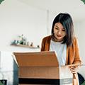 woman unpacking box