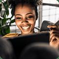 woman smiling at tablet